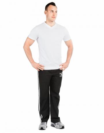Мужские спортивные брюки STP WIND BREAKERМужские спортивные брюки<br>Спортивные брюки с заниженной талией. Подкладка - сетка. В поясе эластичная тесьма и шнурки. Спереди карманы. Внизу брюк молнии. Модель декорирована лампасами и апликацией. Идеально для тренировкок в зале и на улице .<br><br>Размер INT: S<br>Цвет: Черный